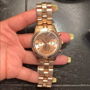 American Eagle rose gold watch.